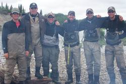 Our son Tyler with his dad and all the fishing guides. (New Halen Lake Lodge 2012)